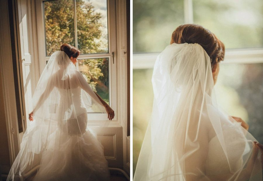 Irish weddings, color portrait of beautiful bride from behind looking out window