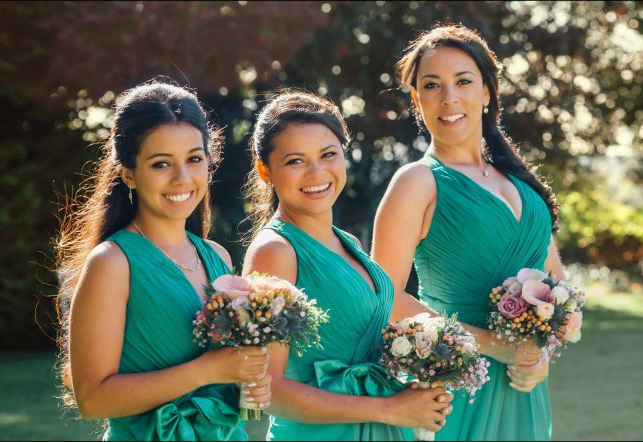 Irish weddings, color portrait bridesmaids, green dress, golden hour, sun flare lighting