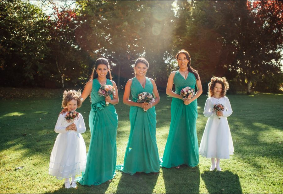 Irish weddings, color portrait bridesmaids & flower girls, golden hour, sun flare