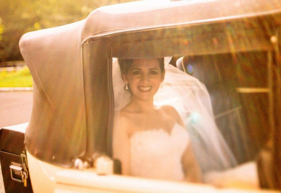 Franciscan Abbey Multyfarnham, bride arrives, golden light, sun flare, antique car, vintage photo
