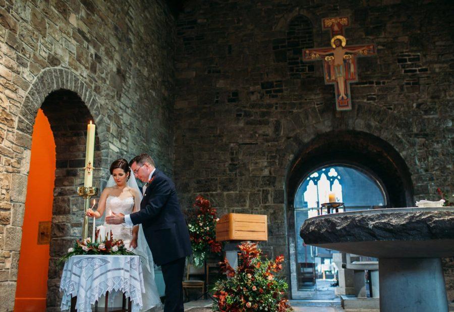 Franciscan Abbey Multyfarnham, wedding, natural light, lighting candle