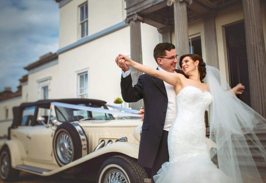 Middleton Park House Hotel, vintage car, wedding couple embracing, movie 'Titanic pose'