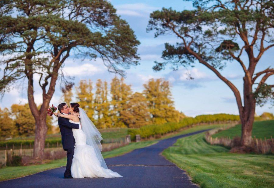 Middleton Park House Hotel, evening light, wedding couple kissing under large trees
