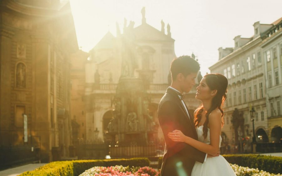 image of bride & groom, Charles Bridge, sunrise, Prague, veil, couple portrait