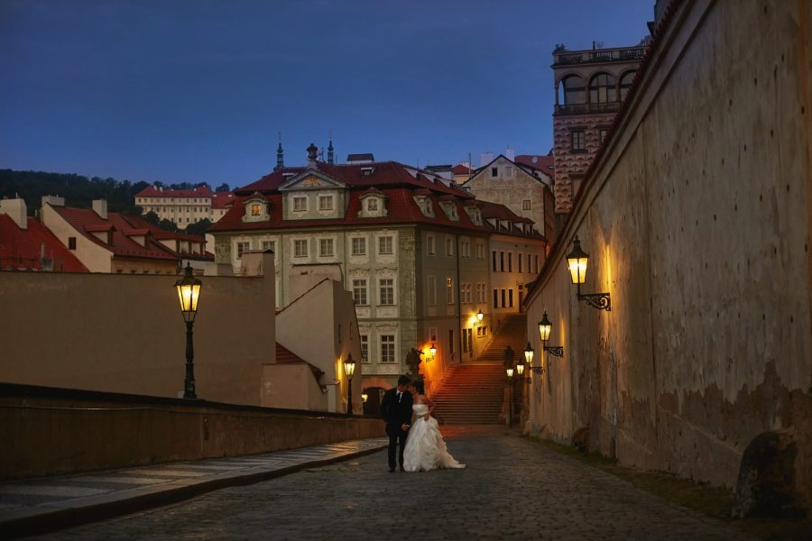 Prague Castle at night, wedding couple, walking, kissing, gas lamps, blue sky, romantic photo