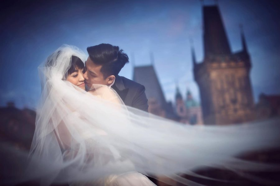 Prague Charles Bridge at night, wedding couple, kissing, under veil, romantic & modern portrait