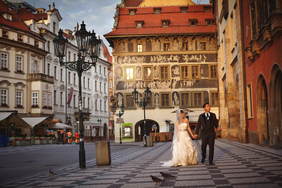 Prague Old Town, walking hand in hand, wedding couple, wedding dress, sun flare, romantic