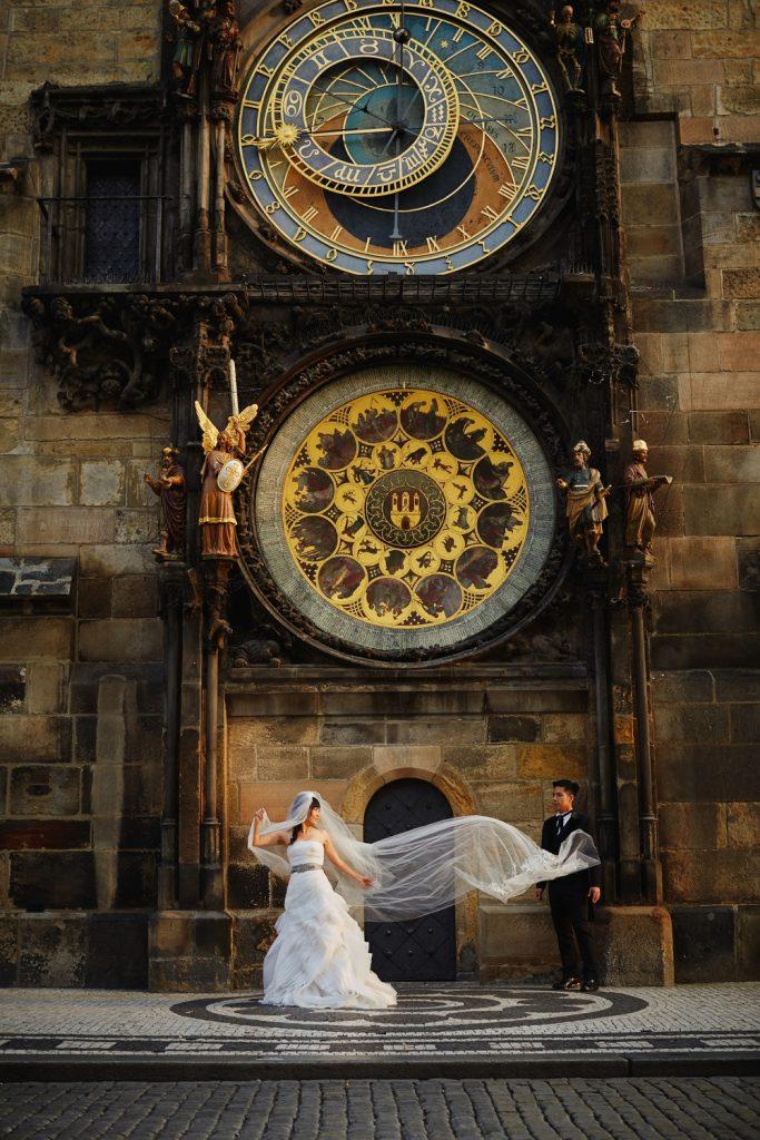 Prague Old Town, Astronomical clock, bridal portrait, veil, happy couple