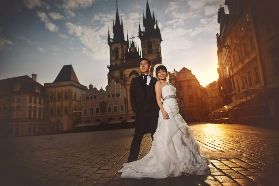 Prague Old Town Square, wedding couple, modern style posed portrait, sun flare, sunrise, Tyn Church