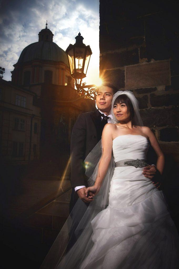 Prague, powder tower, wedding couple, sun flare, couple embracing, sun flare, dramatic portrait