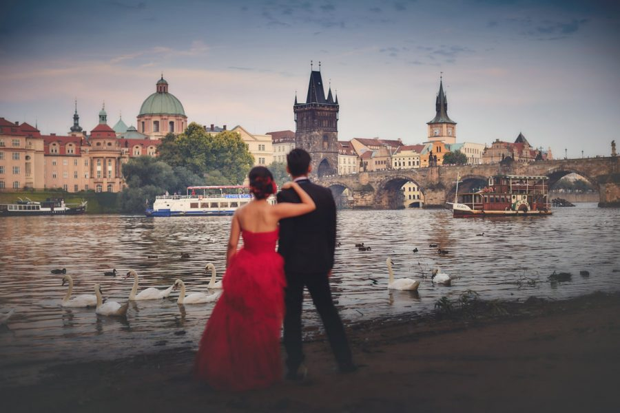 Prague, Charles Bridge, riverside, red dress, couple holding each other, boats, swans