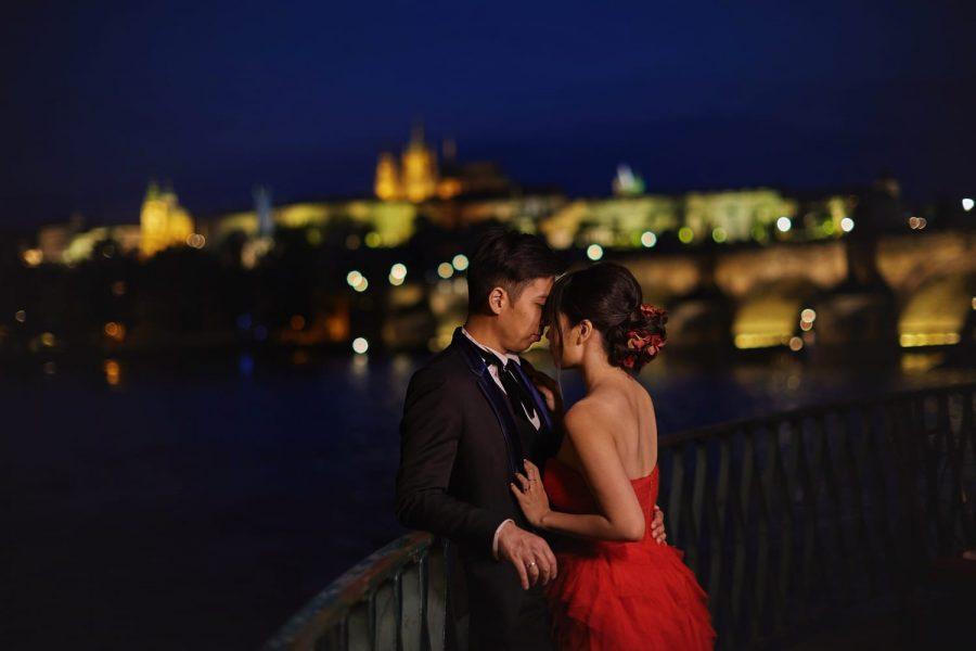Prague, Charles Bridge at night, red dress, intimate couple