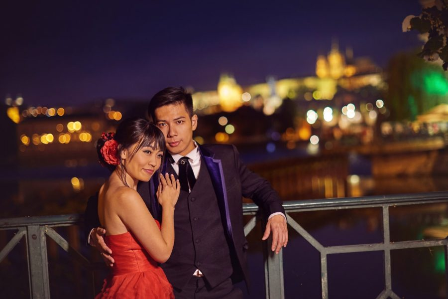Prague, Charles Bridge, Prague Castle in background, couple embracing foreground, night portrait