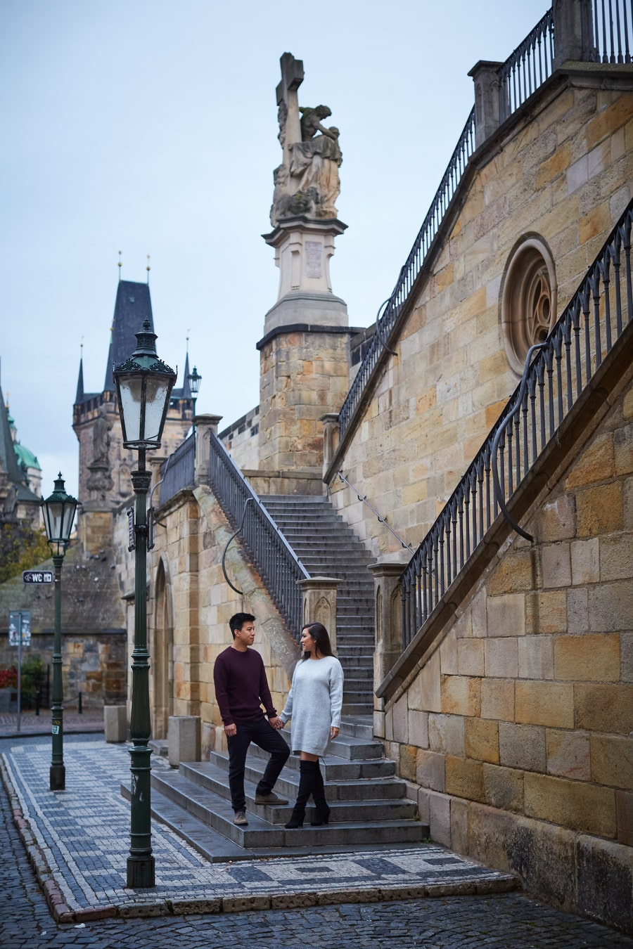 Prague Charles Bridge, stylish young couple holding hands