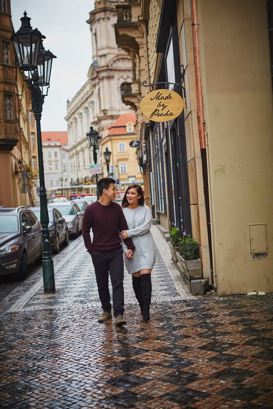 Prague, stylish young couple walking, holding hands, street scene