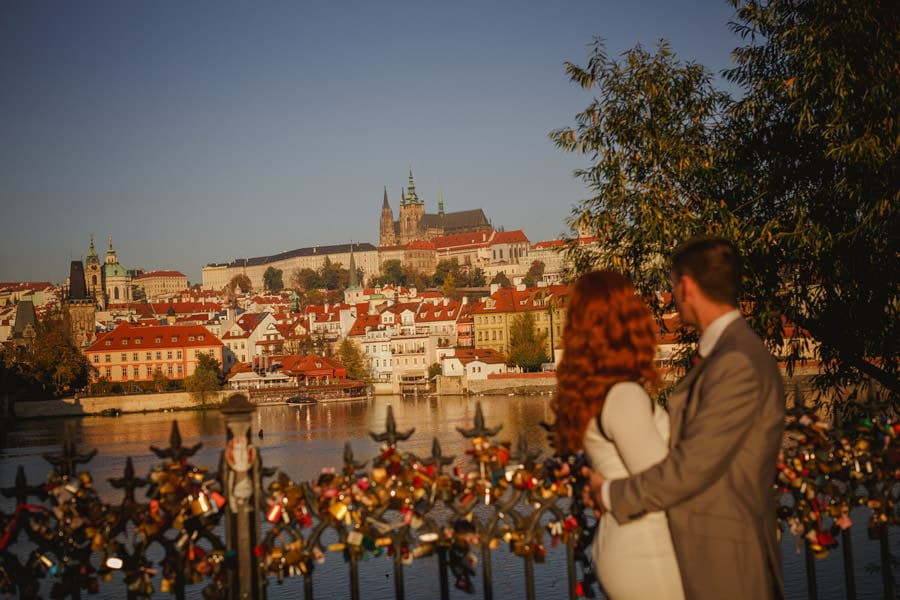 Prague Castle, Prague Charles Bridge, sunrise, well dressed couple embracing