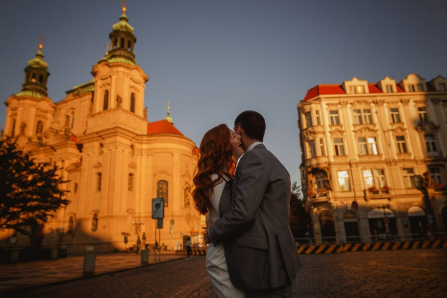 Prague Old Town Square, sunrise, Golden & Orange color, couple laughing and embracing