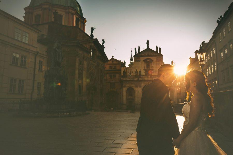 Prague, happy couple, wedding dress, sun flare, moody portrait, happy couple