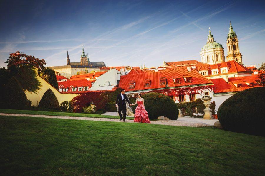 Prague Vrtba Garden, St. Nicholas Church, Prague Castle, red dress, young couple walking