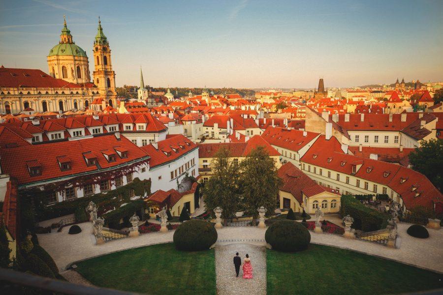 Prague Vrtba Garden, St. Nicholas Church, red dress, couple walking, wide angle lens, skyline