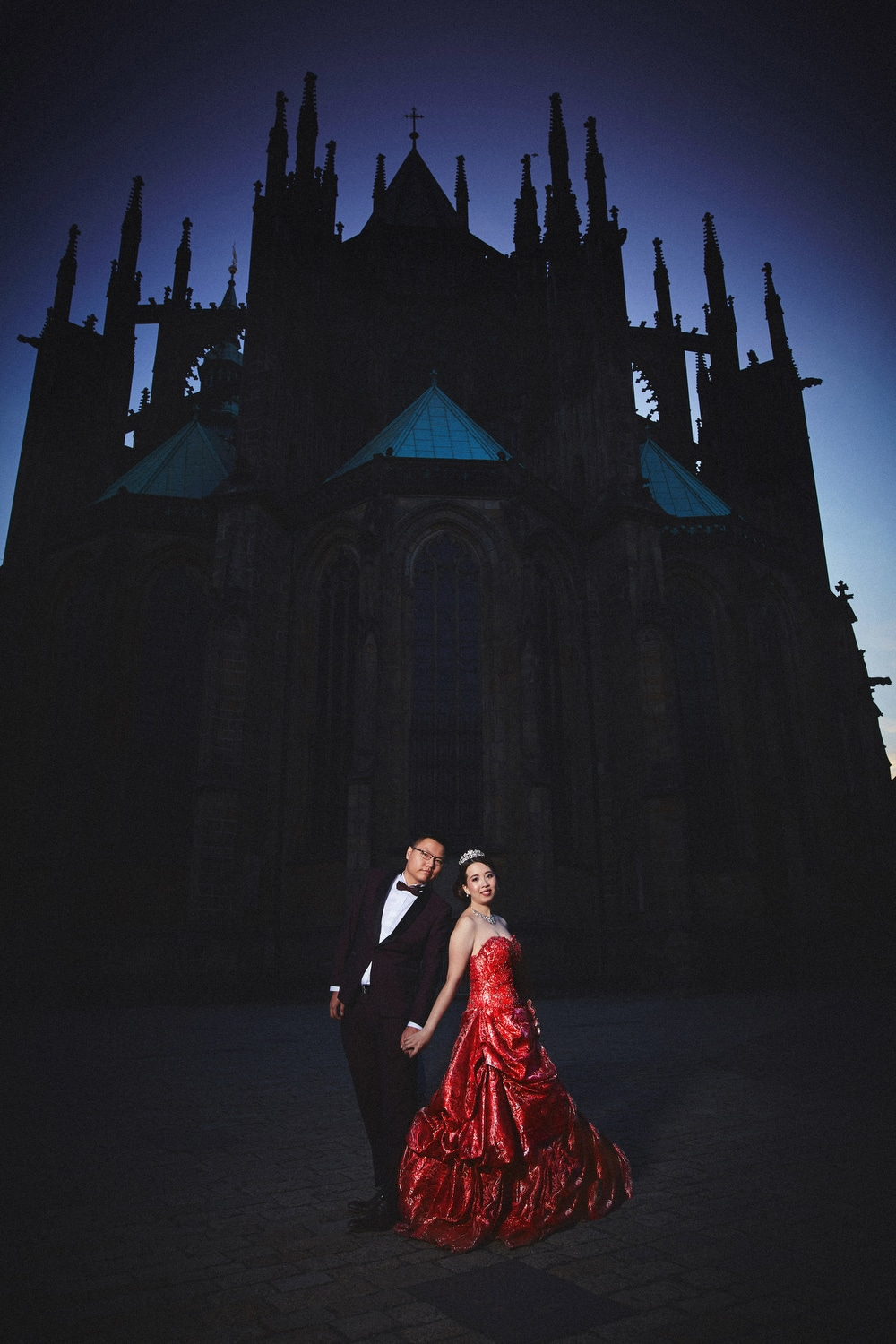 Prague Castle, young couple holding hands, red dress, night image, St. Vitus, blue sky