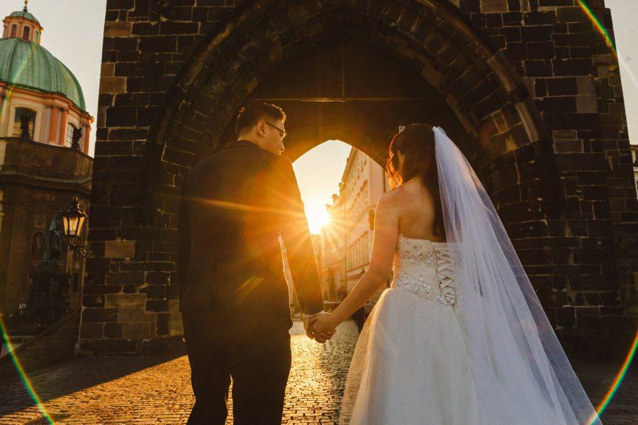 Prague, Charles Bridge, couple portrait, wedding dress, sun flare, Powder Tower