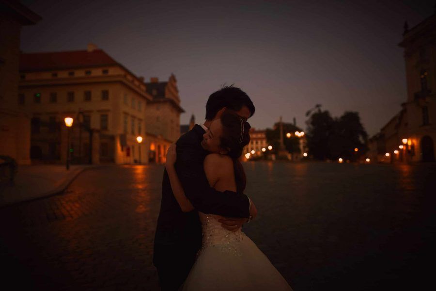 An intimate hug at Prague Castle pre dawn - T+K Prague pre-weddings
