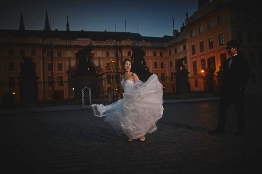 The bride spinning around in her wedding dress at Prague Castle pre dawn - T+K pre-wedding