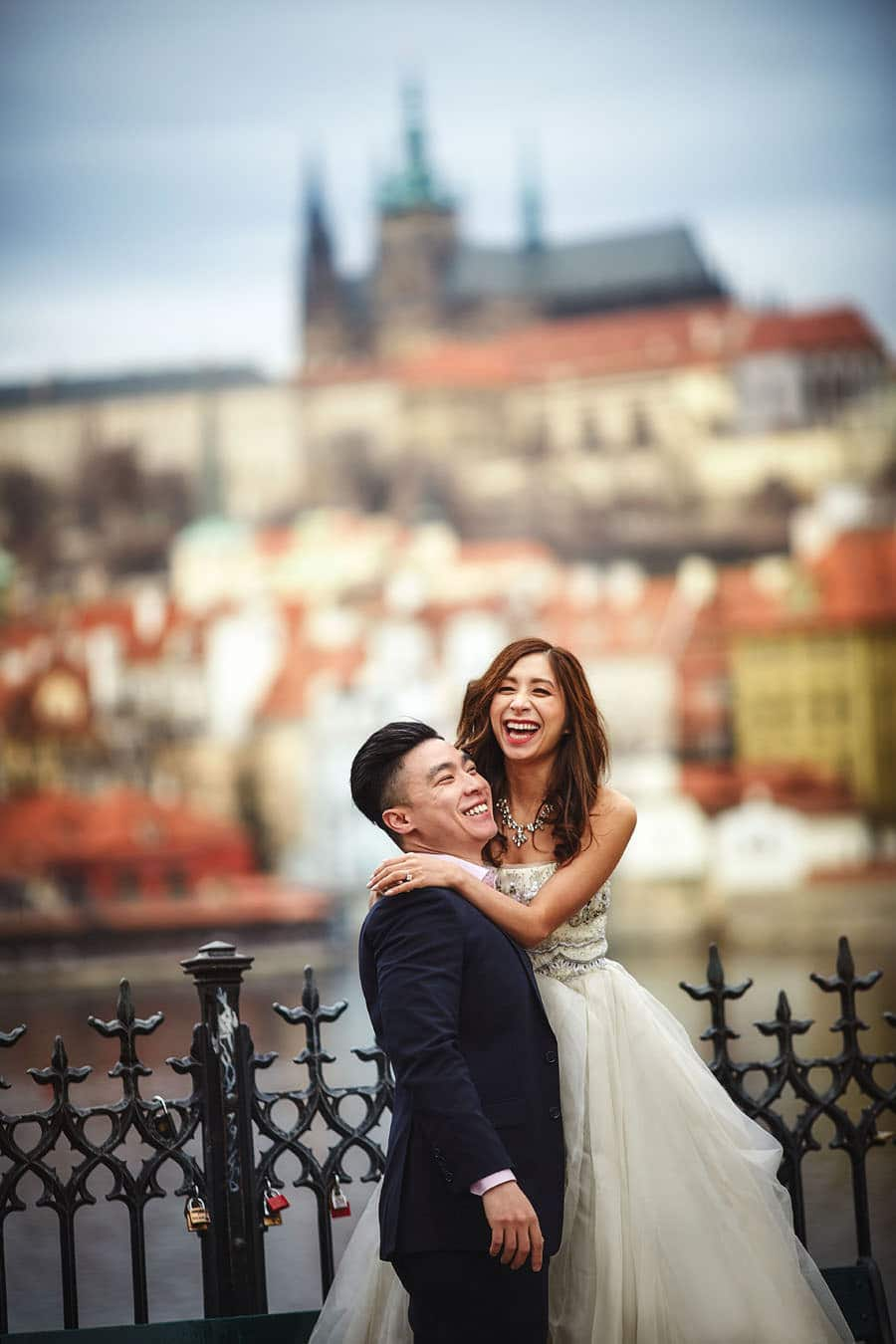 Having a laugh at the Charles Bridge in Prague - a Love Story Engagement photo shoot with Tina & Mike