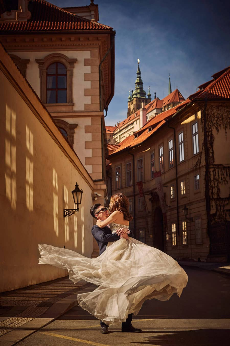 Spinning the bride to be under Prague Castle - from a Love Story Engagement photo shoot with Tina & Mike in Prague