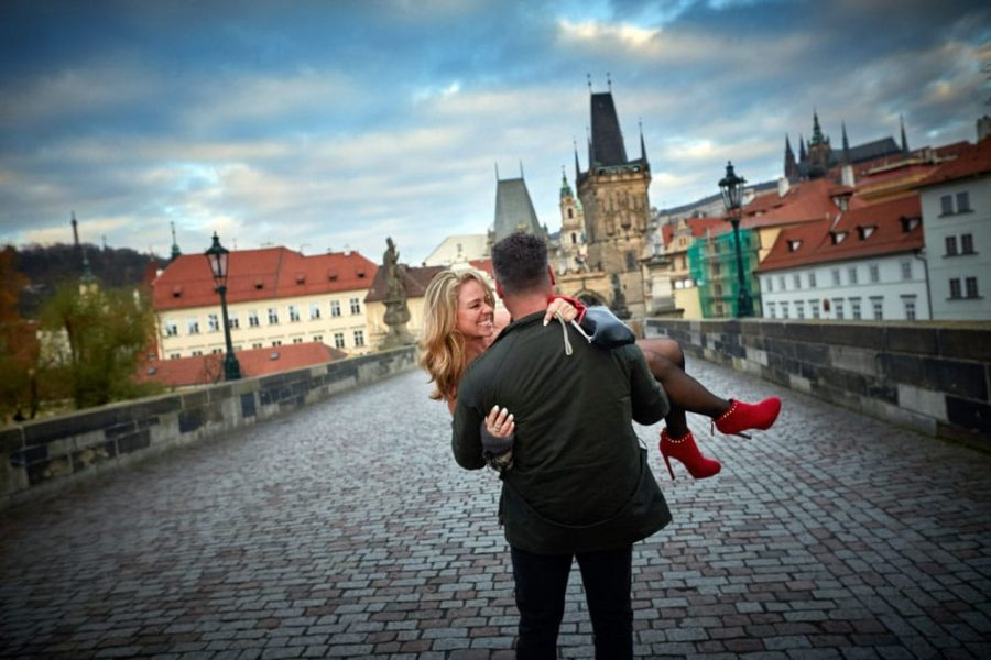 Carrying her off the Charles Bridge - Prague lifestyle photos