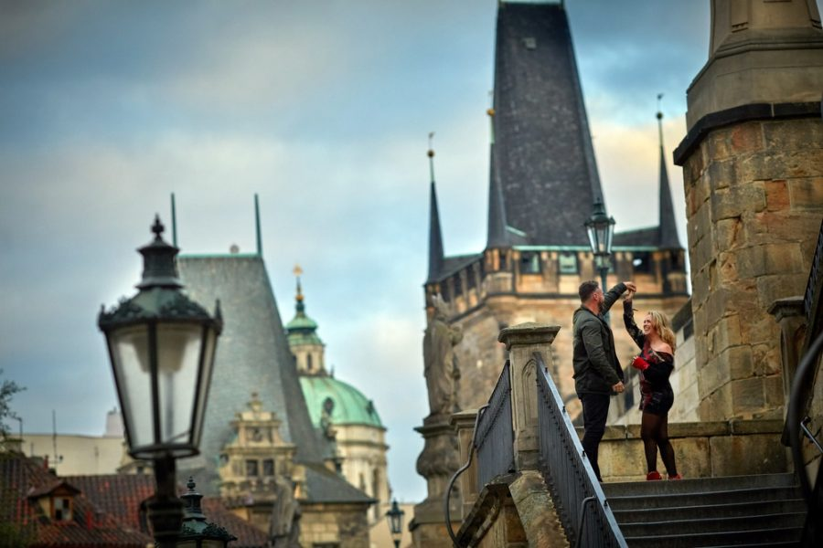 C+M lifestyle photo session that became a surprise marriage proposal near the Charles Bridge. Photography by Kurt Vinion