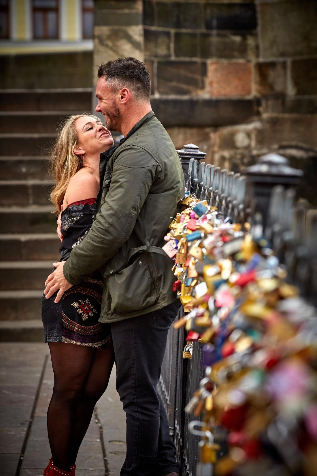 Lovers at the love locks near the Charles Bridge