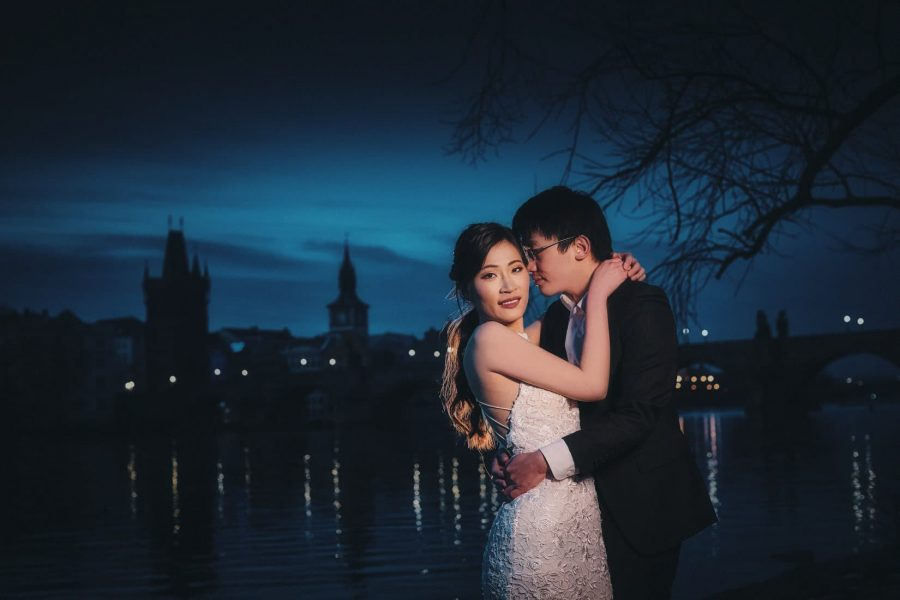 The deep blue sky and the night time peace of the Charles Bridge provides the magical background as J+T embrace during their photo session.