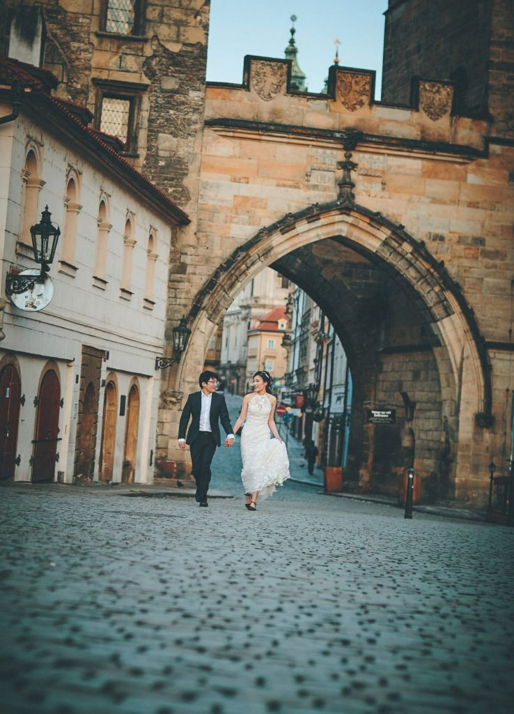 A very happy J+T arrive to a deserted Charles Bridge in their wedding attire during their sunrise photo session.