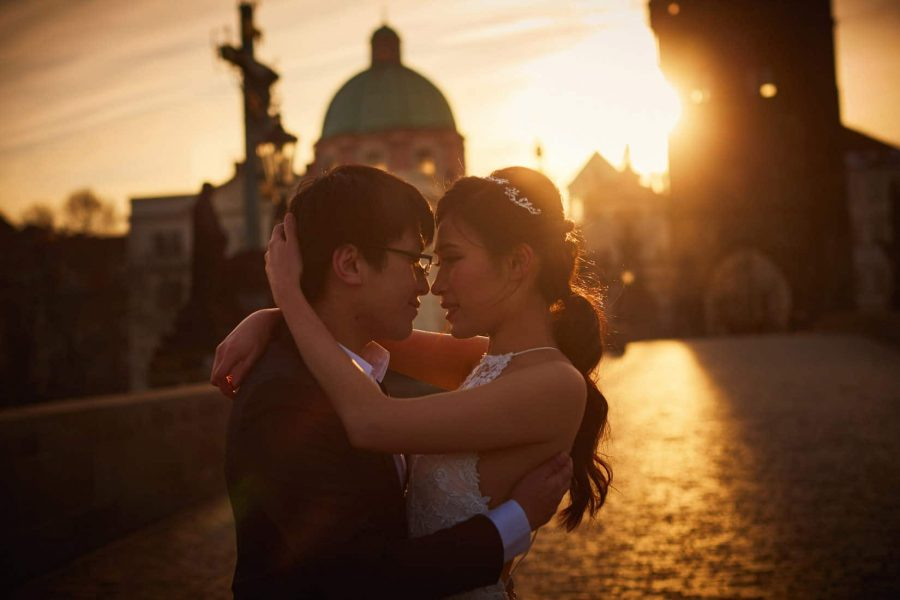 One of my favorite authentic moments during their sunrise pre-wedding photo session on the Charles Bridge.
