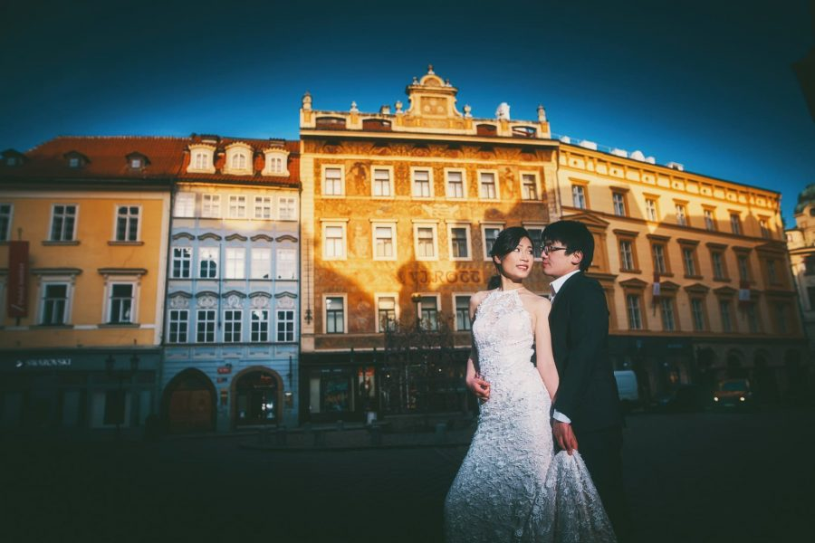 Old world architecture near the Old Town Square provides the colorful backdrop to our soon to be newlyweds during their photo session.
