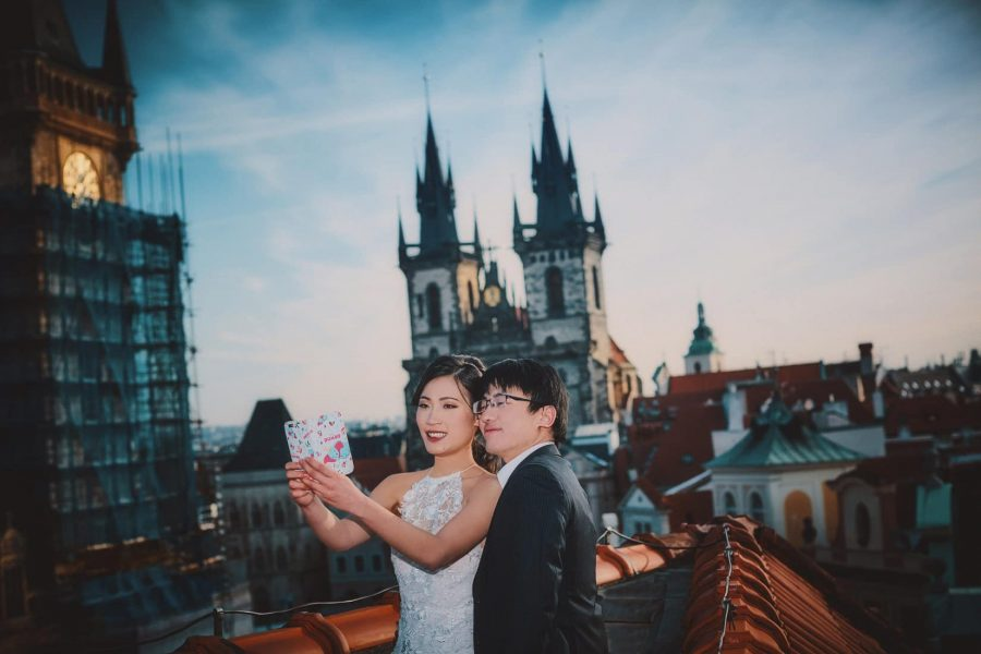 J+T pose for a selfie atop the U Prince roof top terrace overlooking Old Town Square during their early morning photo session in Prague.